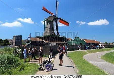 Zaanse Schans, Netherlands - July 9, 2017: People Visit Zaanse Schans Restored Village In The Nether