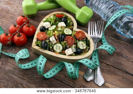Authentic Fresh Salad In A Wooden Heart Shaped Cup With Dumbbells Excercise Equipment, Measuring Tap