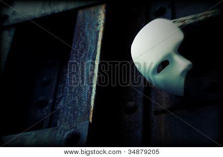 Masquerade - Phantom of the Opera Mask on Rusty Bridge Column