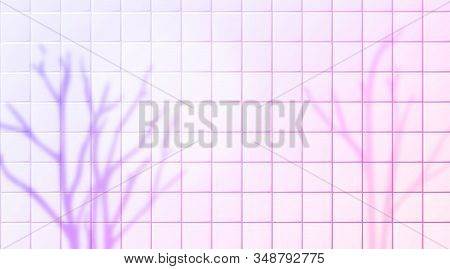 Naked Trees Shadow Overlay Silhouettes On Pink Tiles Wall. Purple Trendy Background With Blurred Bra