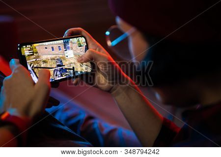 Moscow, Russia - December 2019: Playing A Pubg Mobile Battle Royale Games On Apple Iphone 11 Pro Gam