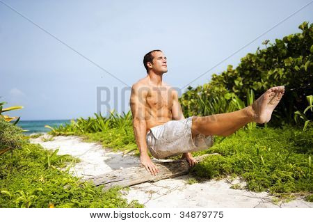 Attractive man training outdoors