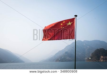 The China Flag Decorated On The Traveling Boat In The Three Gorge Dam.