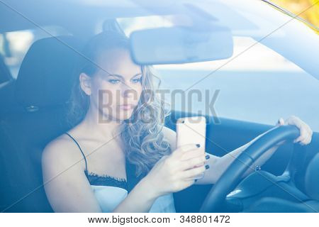 woman texting and talking on cellphone or mobile phone
