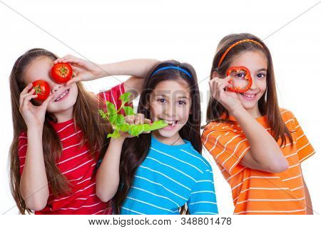 Happy colourful smiling kids playing with healthy vegetables
