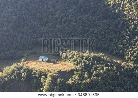Lonely House In The Mountains In The Forest.