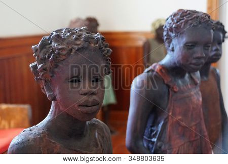 Edgard, Louisiana, U.s.a - February 2, 2020 - The Statue Of The African American Girl Inside The Chu