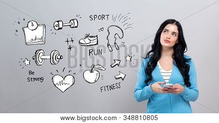 Fitness And Diet With Thoughtful Young Woman Holding A Smartphone