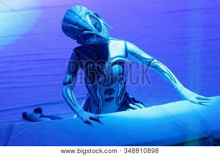 ST. PETERSBURG, RUSSIA - DECEMBER 27, 2019: Circus actor dressed as extraterranean on the circus arena during the premiere of the show OFU. Landing in Saint-Petersburg