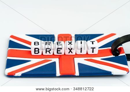 Cube Block With Alphabets Building The Word Brexit On Union Jack Uk Flag Travel Luckage Label With W