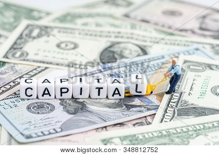 Miniature People Man Pulling Forklift With Cube Small Block Building The Word Capital On Pile Of Us
