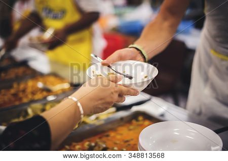 Food Sharing With The Homeless In Society : Concept Of Famine And Charity Food