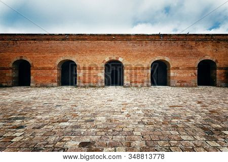 Walkway with arch structure. Castell de Montjuic Fortress in Barcelona, Spain