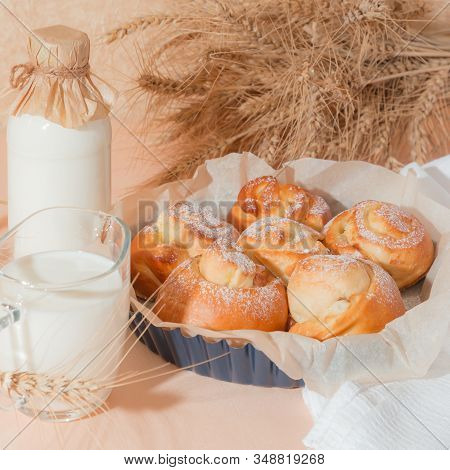 Food, Pastry, Baking. Freshly Baked Homemade Snail Buns With Milk In A Jug And A Glass Bottle. Balan