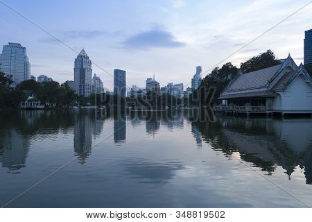 City Scape View From The Lumphini Park In Bangkok At Dusk.