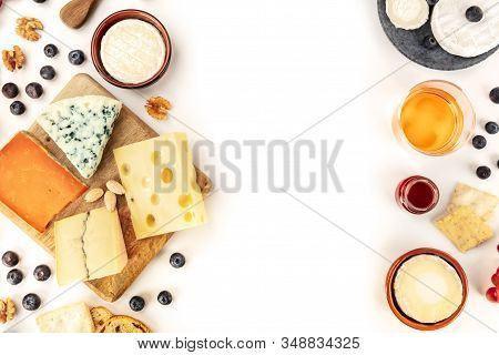 Cheese Design, An Overhead Shot On A White Background With A Place For Text. A Variety Of Cheeses Wi