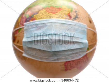 Globe In Protective Medical Mask Isolated On White Background. Novel Coronavirus 2019-ncov. Coronavi