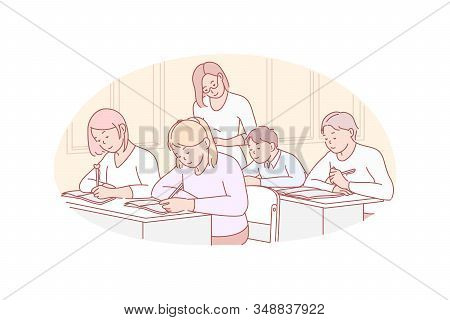 Education, Teaching, School Concept. Young Teacher Examinates School Children. Concentrated Group Of