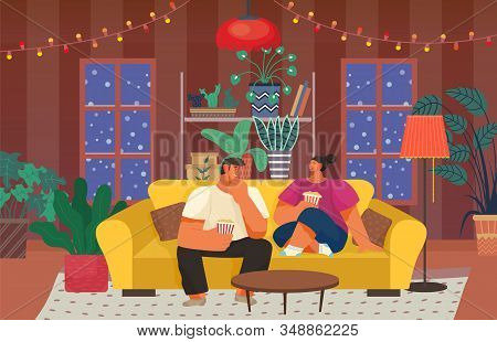 Man And Woman Spending Night At Home, Eating Popcorn And Talking. People Watching Movies In Living R