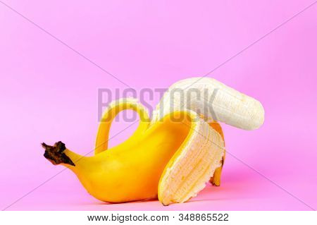 An Open Banana Symbolizing The Male Sexual Organ In An Un-erect State Or Impotence. Pink Background.