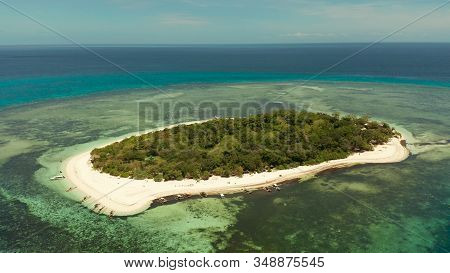 Tropical Island And Sandy Beach Surrounded By Atoll Coral Reef And Blue Sea, Aerial View. Small Isla