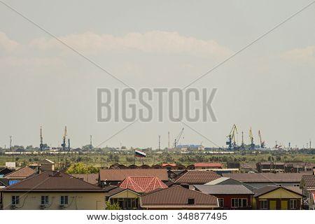 Village Of Golubitskaya. Small Resort Coastal Settlement With View Of Temryuk Port On Hazy Horizon.