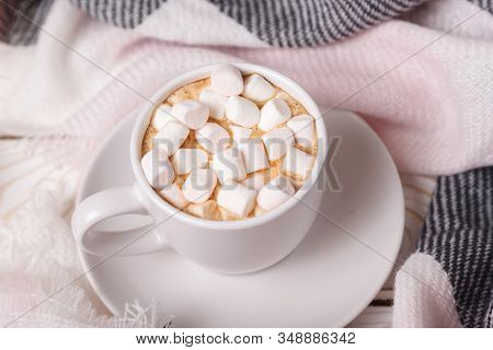 Hot Cocoa In A Cup With Marshmallows On A Bed With A White Knit Blanket. Festive Cozy Atmosphere. Cu