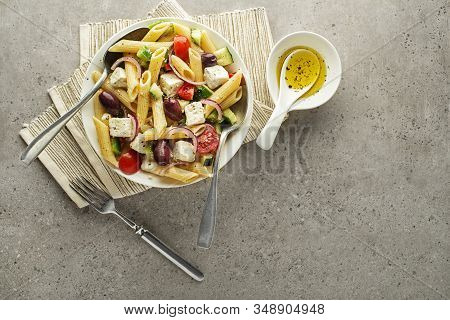 Pasta Salad With Feta Cheese And Vegetables On Grey Background. Greek Salad With Pasta.