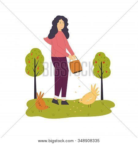 Scene With A Farmer Girl Feeding Funny Hens.