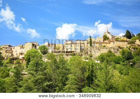 View Of Old Traditional French Small Provencal Village Bonnieux In Sunny Day With Blue Sky On Backgr