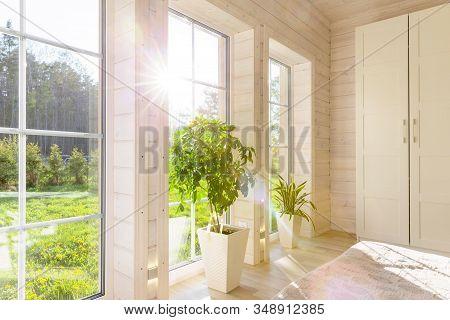 Bright Photo Studio Interior With Big Window, High Ceiling, White Wooden Floor
