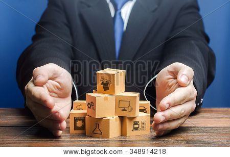 Businessman Covers Boxes Goods. Business Management. Commodity Circulation Import Export. Marketing