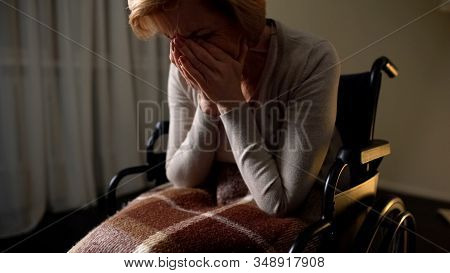 Sick Woman Wheelchair Feeling Lonely And Depressed, Hopelessness In Nursing Home