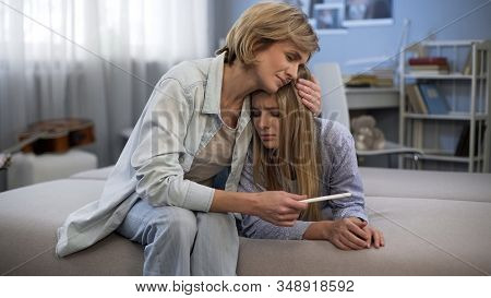 Mum Embracing Upset Daughter, Teenage Pregnancy, Holding Test, Support And Care