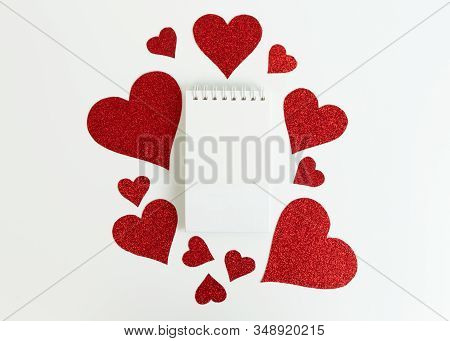 Red Glittery Hearts Isolated On White Backdrop. Copy Space. Valentines Day. Flat Lay Style.