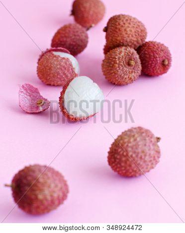 Fresh Litchi Fruits On A Light Pink Background Close Up