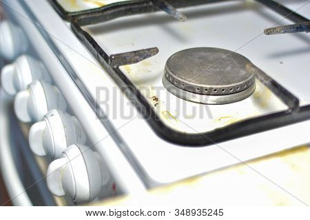 Unwashed Gas Stove. The Concept Of Care And Maintenance Of Gas Appliances, Safe Use And Hygiene.