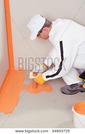 Worker Brush Applied Waterproofing On The Floor Of The Bathroom Pipe Corner Aqueduct Channel