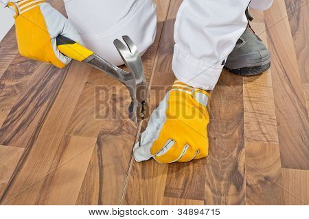 Worker Nailed Old Wooden Floor Cracks