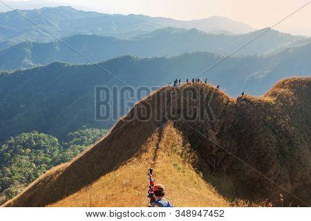 Beautiful Mountain With Trekkers In Sunset At Thong Pha Phum National Park Kanchanaburi Of Thailand