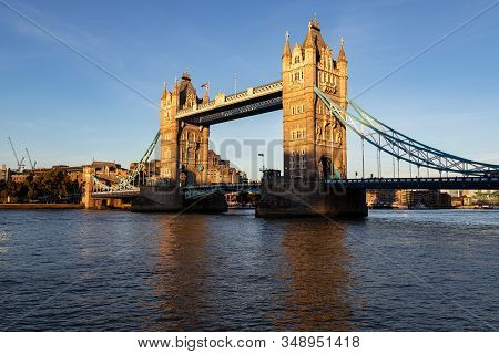 Beautiful Picture Of The Tower Bridge In London During Sunset. The Bridge Is Half In The Shade And H