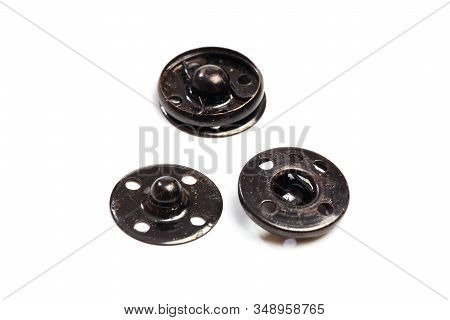 Close Up Of A Group Of Metal Snap On Buttons On White Background - Image