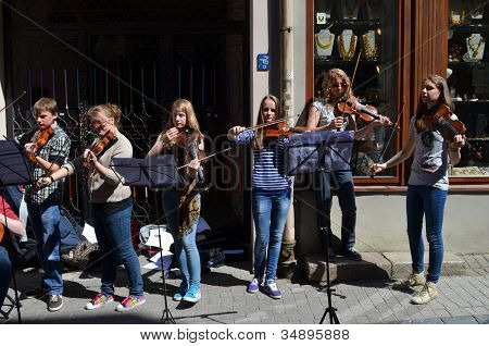 Young People Play Violin In Street Music Day