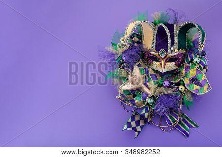 Mardi Gras Wreath On Purple Background With Mardi Gras Mask. Top View