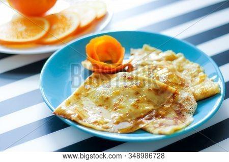 Crepe-suzette Pancakes In Orange-cream Sauce. Homemade Food