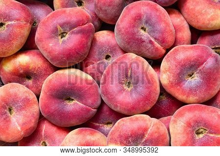 Fig Peach Or Flat Peaches. Delicious Juicy Ripe Saturn Peaches Background. Harvest Of Fresh Tasty Pe