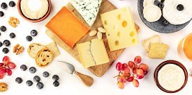 Cheese Platter, A Flatlay Panoramic Banner On A White Background. Blue Cheese, Red Leicester, Emment