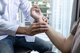 Doctor Physiotherapist Treating Rehabilitation Arm Pain Patient Doing Physical Therapy Exercises Wit
