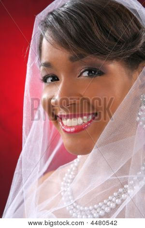 Beautiful Bride Headshot On Red Background