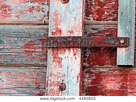 Worn Red Paint On Wood